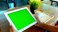 Green screen Digital tablet with breakfast