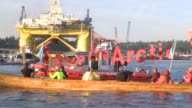 Greenpeace activists paddling in kayaks formed a blockade Monday to keep a mammoth Shell oil rig from departing from Seattle on a mission to drill in...