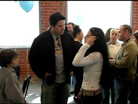 Greg Grunberg son Jake and Amy Lee of Evenescence at the Gibson Guitar 'Paint For PEP' Charity Event at Gibson Baldwin Showroom in Beverly Hills...