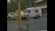 Greg Pearce newsreader intro Queen Street Massacre witnesses / vox pops eyewitness on street account / Police walk / police car drives / police at...