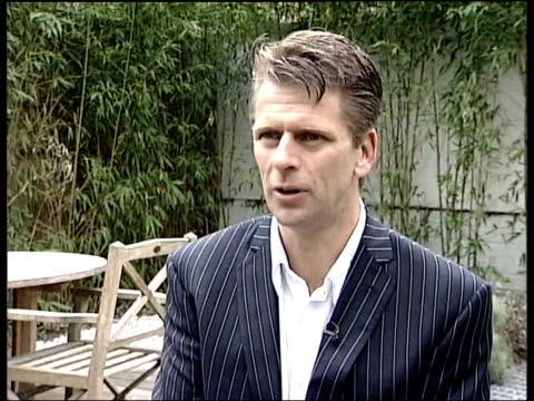 Greg Rusedski cleared on drug charges ITN London EXT Andrew Castle interviewed SOT In this case an innocent man has been found innocent i/c LATE