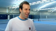 Greg Rusedski practicing on court and interview SOT