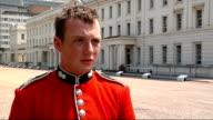 Grenadier Guard taking off bearskin hat to reveal sweating head Guardsman Danny Ryan interview SOT Grenadier guard on duty
