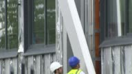 120 high rise buildings fail fire safety tests / Issue of insulation Manchester Salford Cladding being removed by workers
