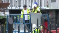 75 highrise blocks fail fire safety checks Greater Manchester Salford EXT Various of workers removing cladding from high rise building Jamie...