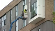 75 highrise blocks fail fire safety checks ENGLAND Merseyside Sefton Bootle EXT Wide shot of blocks of flats with cherry picker platform alongside...