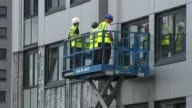 75 highrise blocks fail fire safety checks ENGLAND Greater Manchester Salford EXT Various of workers removing cladding from high rise building