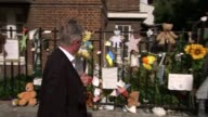 Deadline for submitting inquiry questions approaches **Atkinson interview overlaid SOT* Man along past memorials tied to fence Councillor Robert...