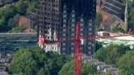 Death toll may be lowered as police investigate cases of fraud LIB Blackened shell of Grenfell Tower