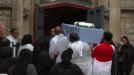 Funeral of fiveyearold victim Isaac Paulos ENGLAND London Battersea EXT Coffin of Isaac Paulos being carried into church followed by grieving...