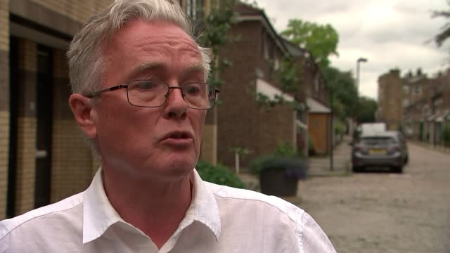 Government says they are on target to find temporary homes for affected residents EXT Cllr Robert Atkinson interview SOT Close shot scorched wall of...