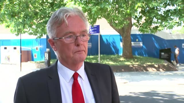 Government sends in taskforce North Kensington EXT Councillor Robert Atkinson talking with reporter Grenfell Tower seen through trees Councillor...