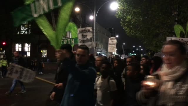 Inquiry criticised for slow pace of progress ENGLAND London Various of Grenfell protesters along with signs and placards Antonion Roncolato setup...