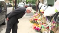 Inquiry to begin amid controversy 3 months after fire T29061727 / TX North Kensington Various of Sir Martin MooreBick looking at flowers and other...