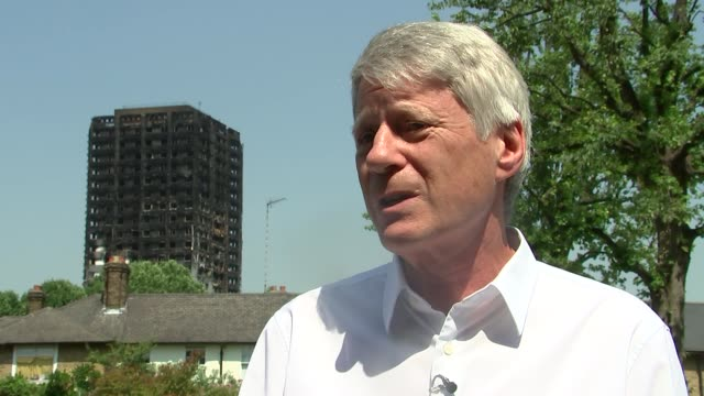 interior shots of cordoned off area external shots of burned tower ENGLAND West London Latimer Road EXT Nick Ross interview on sprinklers SOT /...