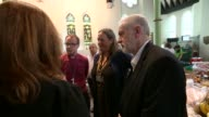 Jeremy Corbyn visit Labour Party leader Jeremy Corbyn chatting with people in church