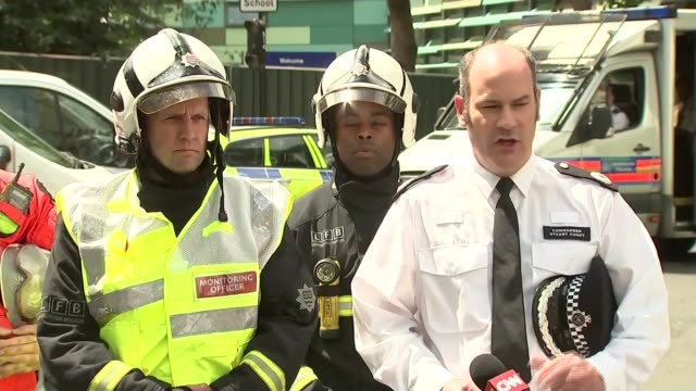 joint police and fire brigade press conference Cmdr Stuart Cundy and Richard Mills answer press questions SOT / all walk away at end of press...