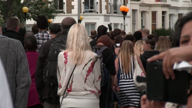 Monthly silent march numbers grow R140817010 / ENGLAND London Kensington EXT **Cred interview overlaid SOT** People away during silent march to mark...