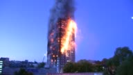 Overnight general views Burning Grenfell Tower / smoke and flames rising / water being hosed at burning building from cherry picker platform / water...