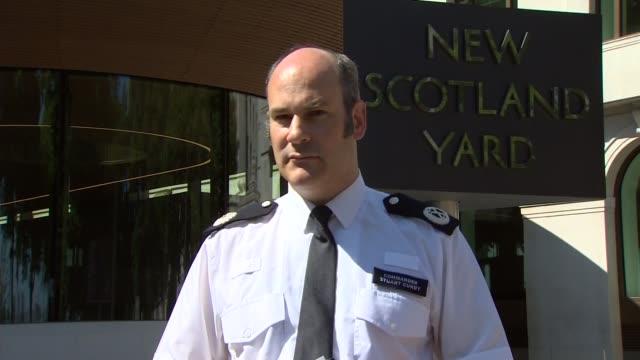 Police press conference ENGLAND London New Scotland Yard EXT Commander Stuart Cundy press conference SOT