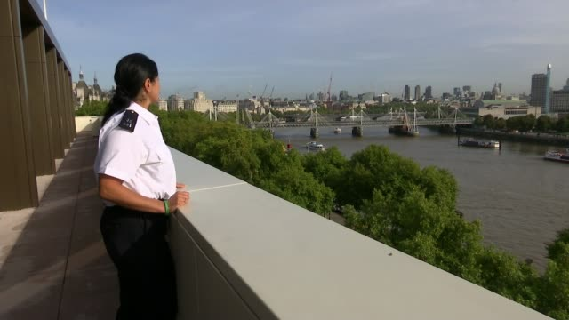 Police put final death toll at 71 T13101701 / TX Westminster New Scotland Yatrd EXT Constable Loraine Verghese on balcony and interview SOT