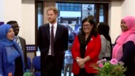 Princes William and Harry visit AlManaar Muslim Cultural Heritage Centre INT Prince Harry chatting to women inside centre / Harry cutting cake with...