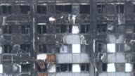 Retired judge Sir Martin MooreBick to lead disaster inquiry Various of blackened shell of Grenfell Tower block of flats with firefighters seen at...