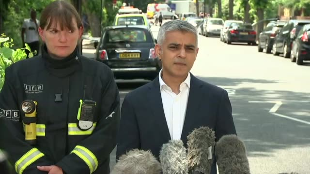 Sadiq Khan Dany Cotton and Paul Woodrow press conference ENGLAND London North Kensington EXT Sadiq Khan Dany Cotton and Paul Woodrow towards to speak...