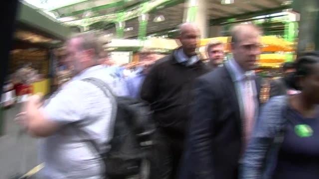 Sadiq Khan interview during visit to Borough Market ENGLAND London Borough Market EXT Sadiq Khan standing with others chatting / Khan along / Khan...
