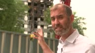 third key cladding product revealed London North Kensington EXT Reporter to camera/ Close shots of firedamaged exterior wall of Grenfell Tower...