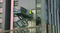 Tower block safety concern over who will pay to fix cladding problems ENGLAND Greater Manchester Salford EXT Workers removing exterior cladding from...