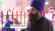 Volunteers come together to collect supplies for those in need ENGLAND London North Kensington EXT Tufaan Singh stands in street calling out 'food...