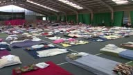 Westway Sports Centre hosts open day for volunteers and survivors T14061745 / TX ENGLAND London North Kensington Westway Sports Centre INT Sleeping...