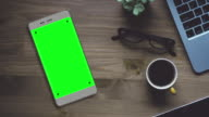 Grey Smartphone on Desk with Chroma Key Green Screen