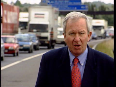 Amount of traffic EN NORMAN REES ENGLAND West Midlands M6 Lorries moving slowly towards along busy road LA MS Slow moving cars towards past TGV Slow...