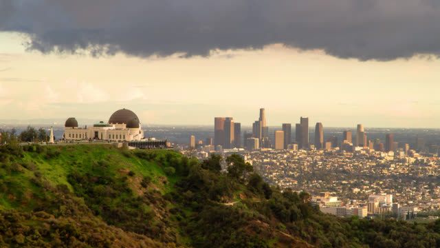 T/L WA HA Griffith Observatory and downtown skyline transition day to night / Los Angeles