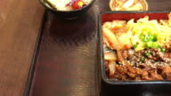 grilled pork on top rice - japanese food