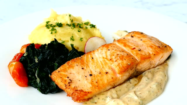 Grilled salmon meat fillet steak with vegetable and sauce