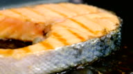 Grilled salmon steak on cast-iron grill pan