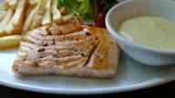 grilled salmon steaks slowmotion