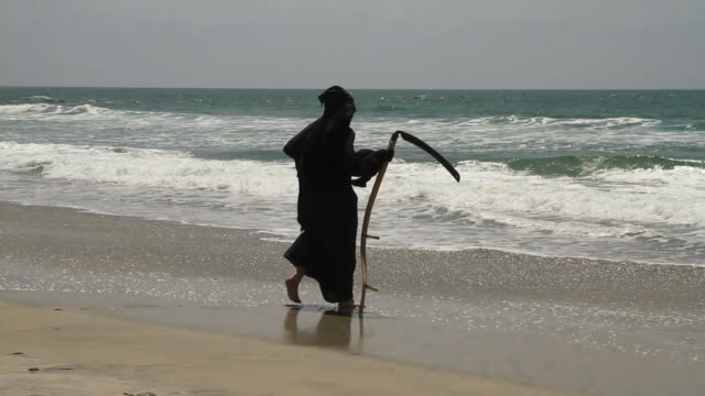 grim reaper wades in water