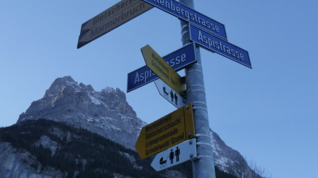 Grindelwald Village, Signpost and Mount Eiger, Bernese Oberland, Canton of Bern, Switzerland, Europe