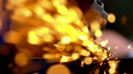 SLO MO Grinding a piece of steel with an angle grinder