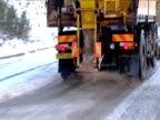 Gritter lorry spreads grit onto snowy road Scotland
