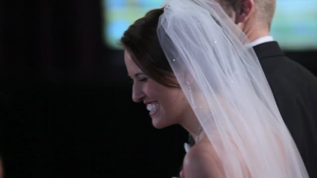 CU Groom and bride leave down aisle together