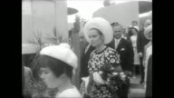 Grounds of Expo 67 in Montreal / Prince Rainier and Princess Grace walking around on Monaco National Day / visit with people and drink champagne /...