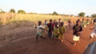 Group of African children running alongside vehicle / children smiling and laughing Group of Happy African Children on November 16 2011 in...