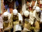 MCU Group of African clerics bowing down in Palm Sunday service, Ethiopia, Africa