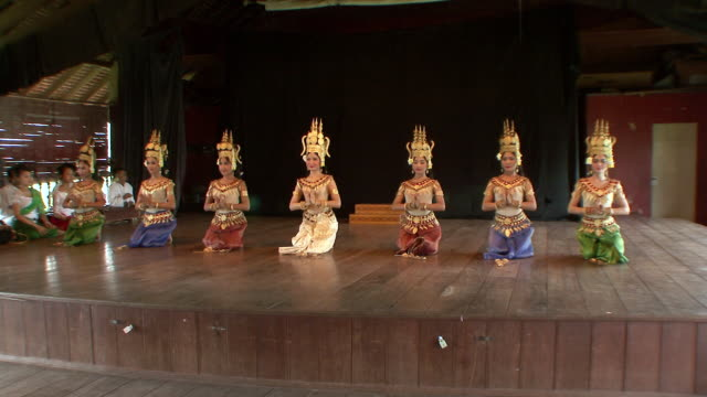 MS Group of apsara dancers performing dance on stage / Phnom Penh, Cambodia