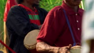 MS PAN group of Asian men in native dress (at bull races) / one plays drums / Madura, Indonesia